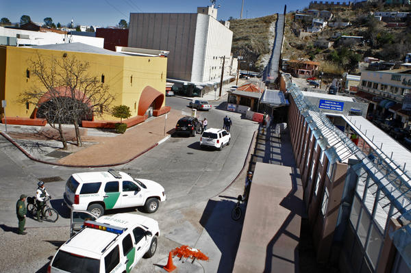 U.S. Border Patrol agents gather near the pedestrian crossing at the Nogales, Arizona, Port of Entry on Feb 26, 2013.  Nogales, Sonora, Mexico is on the right.