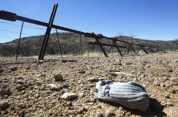 A Normandy-style barrier marks the boundry of Sonora, Mexico and the Chilton cattle ranch in Arivaca, Arizona, on Feb 23, 2013.  Made of steel railroad rails, it serves to stop smuggler's from illegally driving north into Arizona.  A bundled pair of clean socks was probably dropped by one of many illegal immigrants who regularly walk north into the U.S. through the ranch.