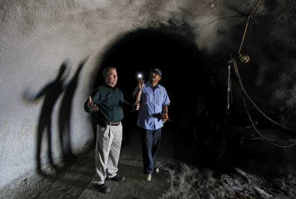 Director of Operations Joe McDivitt, left, and maintenance worker Jimmy Gomez stand in the 2-mile stretch of tunnel on the beach at 10th Street during a tour of the areas in need of repair.