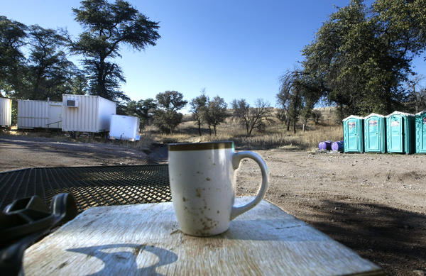 A coffee cup sits on a table at an abandoned U.S. Border Patrol forward operating base near Arivaca, Arizona. Before it was shuttered due to budget shortages related to overtime costs, agents were based here 24-hours per day, putting them much closer to the border.