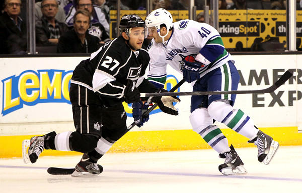 Kings defenseman Alec Martinez turns to defend Canucks winger Maxim Lapierre during a game earlier this season.