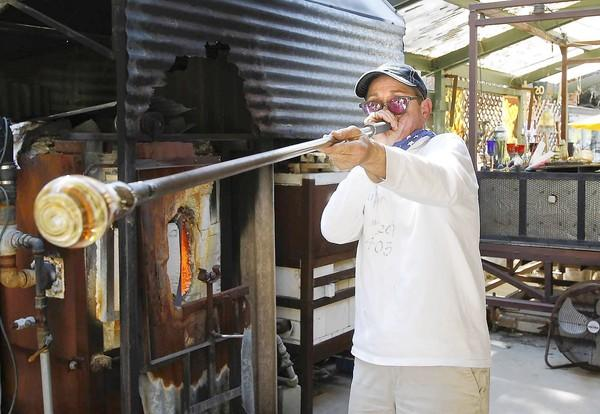 Glassblower Muffin Spencer-Devlin works on a small bowl in her Laguna Canyon studio.