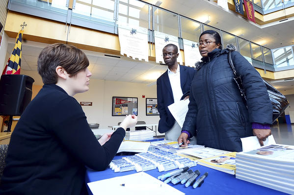 Holly Matheis, left, an academic advisor with the University of Maryland University College, talks with prospective students Pastor Fidelis Nwachukwu and his wife, Susan Nwachukwu, during an open house Thursday at the University System of Maryland at Hagerstown.