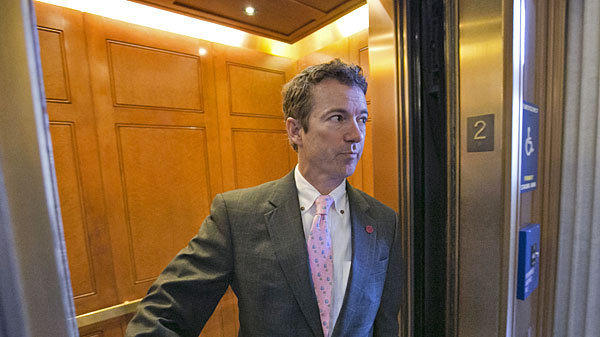 Sen. Rand Paul (R-Ky.) is questioned by reporters on Capitol Hill.