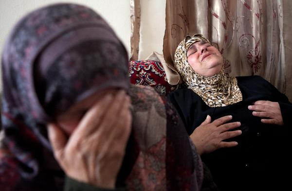 Yusur Asfour, right, the mother of Muhammad Asfour, mourns her son's death with family members at her home in the West Bank village of Aboud. Muhammad Asfour was shot with a rubber-coated bullet by Israeli forces while taking part in a protest supporting Palestinian prisoners in Israeli jails.