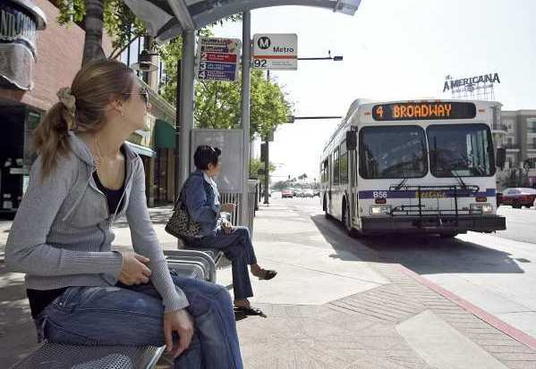 A woman waits for the No. 2 Beeline bus on Brand Blvd. at Harvard St. in Glendale in 2009.