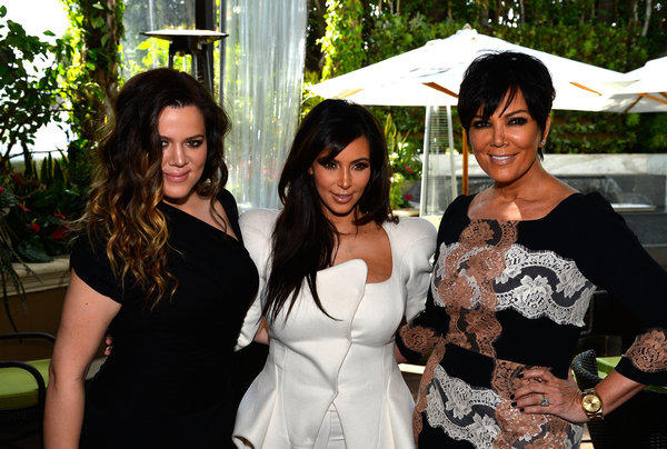 Kim Kardashian is flanked by sister Khloe Kardashian, left, and mom Kris Jenner at DuJour magazine's spring issue celebration in Beverly Hills.