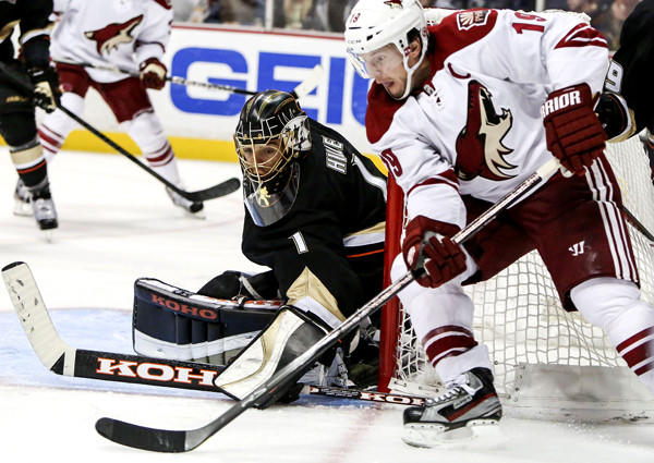 Ducks goalie Jonas Hiller gurds the near post as Coyotes right wing Shane Doan attempts a shot during the third period Wednesday.