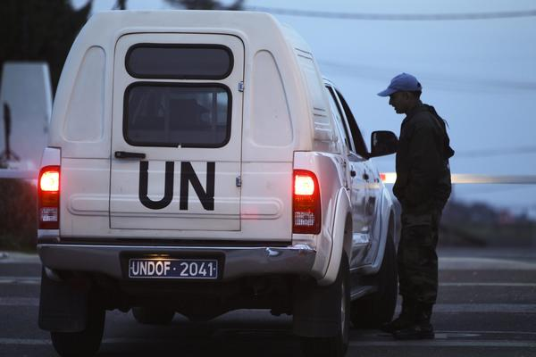 A soldier checks a vehicle entering the U.N. headquarters, the main camp of the Philippine U.N. peacekeeping troops, near Qunitra at the Israeli-Syrian border in the Golan Heights, March 7, 2013.
