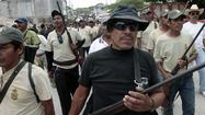 "MEXICO CITY — At least 35 alleged members of a ""self-defense"" vigilante group in southern Mexico were reportedly arrested by the military Thursday, underscoring the tension between government authorities and such groups, which have sprouted up in numerous states in recent months."