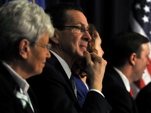 With Lt. Gov. Nancy Wyman at his side, Gov. Dannel P. Malloy listens at a conference on gun violence on Feb. 21 in Danbury attended by Vice President Joe Biden.