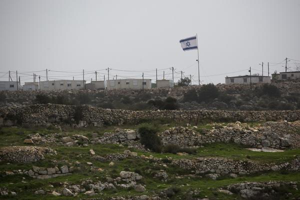 Large Israeli flag at small Jewish settlement of Ha Tamar south of Jerusalem