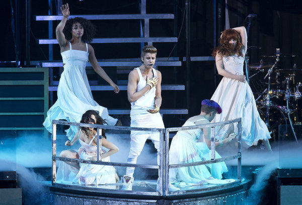 Justin Bieber performs in London on Monday. He collapsed offstage during Thursday's show and was treated for breathing problems, but finished the last four songs of his program before heading to the hospital.