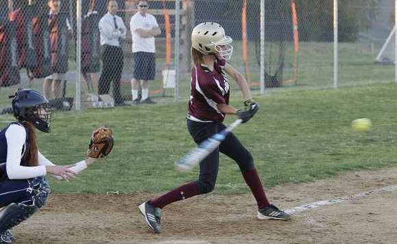 Laguna Beach's Halle Redfearn produces a hit against Capistrano Valley Christian during the Breakers' season opener March 1.
