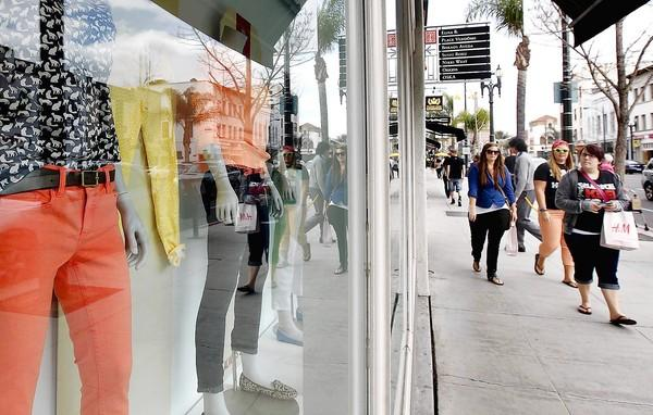 Retail sales are expected to grow 3% to 4% this month partly because of the early Easter holiday, the International Council of Shopping Centers says. Above, shoppers stroll along Colorado Boulevard in Pasadena.