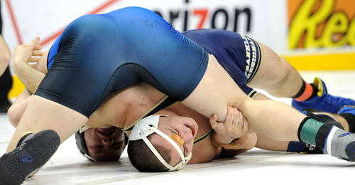 (Top) Nazareth's Aaron Bradley defeats Franklin Regional's Luke Fleck by fall in 3:05 in the 285 pound weight class in the preliminary round of the PIAA Class 3A wrestling championships held at the Giant Center in Hershey on Thursday.