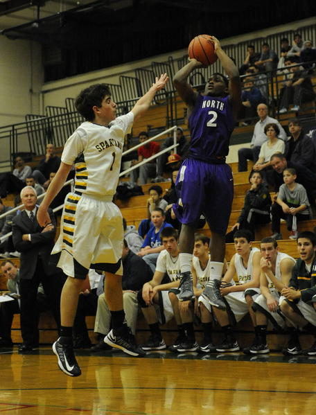 Niles North's Malachi Nix is defended by Glenbrook North's Jason Markus on Tuesday, December 4, 2012.