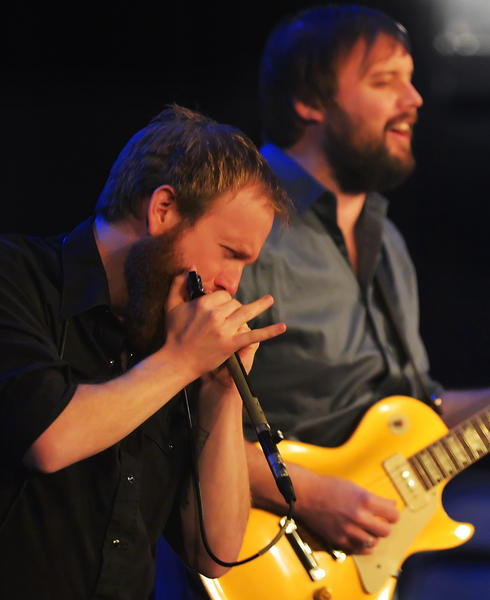 Dustin Arbuckle wails on harmonica and Aaron Moreland plays guitar Thursday night during the Cabin Fever Blues Bash at The Maryland Theatre in downtown Hagerstown. The annual bash is a prelude to the summer's Western Maryland Blues Fest.