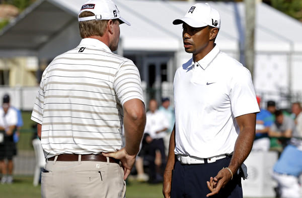 Tiger Woods talks to Steve Stricker on the practice putting green at Doral Golf Resort and Spa on Wednesday.
