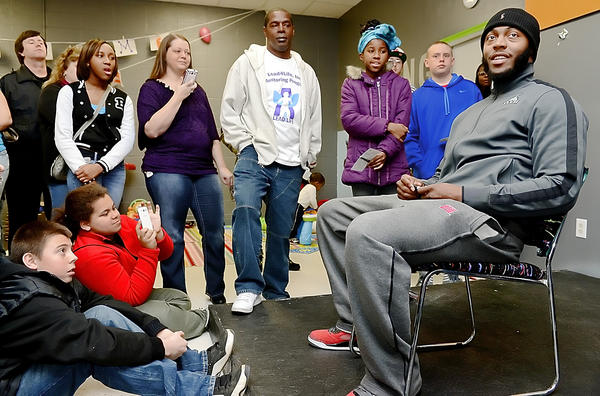 Baltimore Ravens running back Bernard Pierce, seated at right, holds a question-and-answer session with youths during an appearance at The Baby Sitter Child Care Center in Hagerstown on Thursday afternoon.