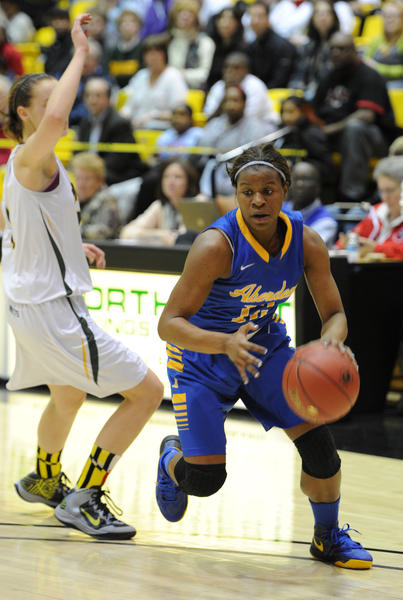 Aberdeen's Jimmia McCluskey gets by the Damascus defender and drives to the hoop during Thursday night's semifinal.