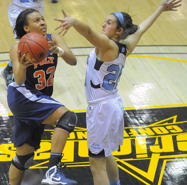 Poly guard/forward Tiera Pendleton drives by Dani Okon to score a basket in Poly's win.