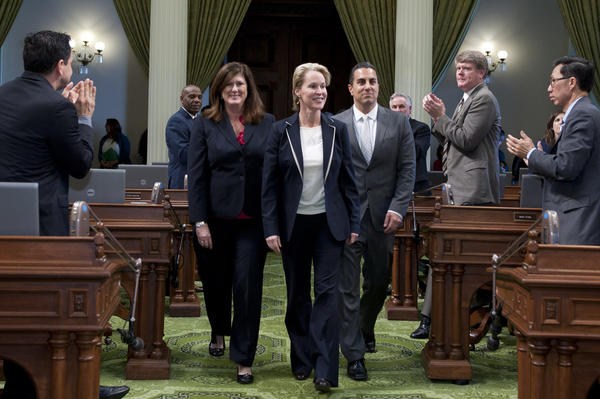 Frances Arnold enters the state Assembly chambers with Assemblyman Mike Gatto (D-Silver Lake) following as she is honored as a Woman of the Year.