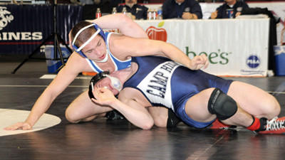 Berlin's Bryce Fochtman, left, battles Quinn Frassetta of Camp Hill at 160 pounds Thursday at the PIAA Class AA Wrestling Championships in Hershey. Fochtman won the match, 14-5.