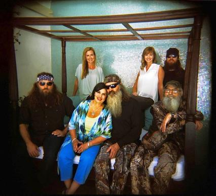 """Duck Dynasty"" on A&E features Willie, left, his wife, Korie, matriarch Kay and her husband, Phil, Missy and her husband, Jase (background) and Si."