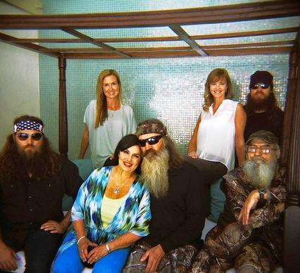 """Duck Dynasty"" on A&E features Willie, left, his wife, Korie, matriarch Kay and her hu"