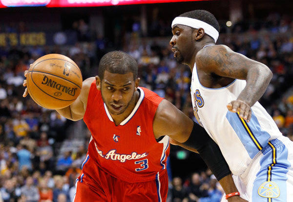 Los Angeles Clippers' Chris Paul (L) tries to get past Denver Nuggets' Ty Lawson during their NBA basketball game in Denver March 7, 2013.
