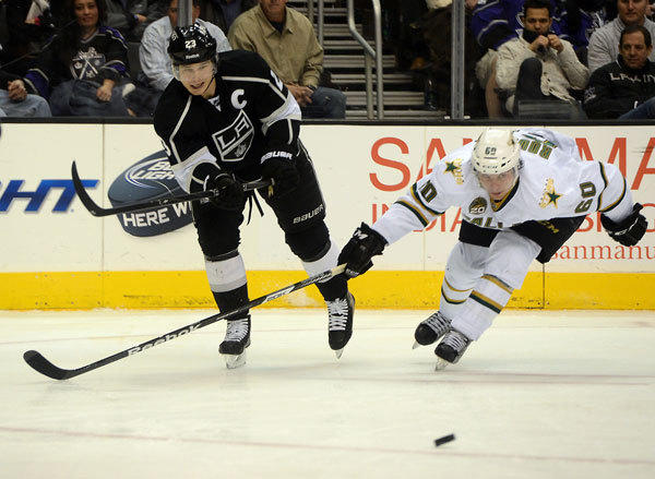 Dallas Stars left wing Antoine Roussel (60) defends a pass by Los Angeles Kings right wing Dustin Brown (23) in the second period at the Staples Center.