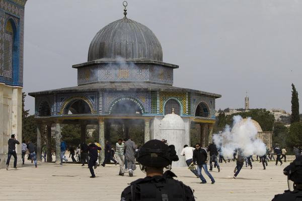 Israeli riot police clash with Palestinian demonstrators at Jerusalem's Al Aqsa Mosque compound following Friday prayers.