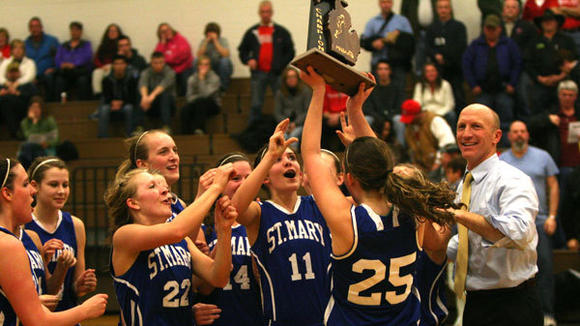 St. Mary girls celebrate with their Regional trophy after defeating Bear Lake, 39-23 in Thursday's final.