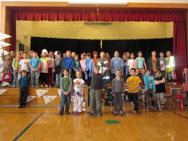 All of the second-graders from Erin Sarki-Fate's and JoEllen Thompson's classes at Sheridan Elementary School pose for a play photo. The play was about our neighborhood helpers.