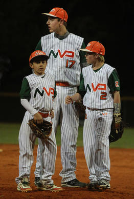"Eric Volpi (center) is a 12-year-old six foot three inch tall 185 pound baseball player from New York recruited to play for Team MVP out of Pembroke Pines. In a phenomenon that could be dubbed ""Moneyball Jr,"" South Florida is at the center of a rapid, recent and disturbing rise in the professionalization of youth baseball, where the top 10-12 year old boys are recruited and flown around the country with their families by wealthy team owners who run youth baseball teams (ages 6-14) like mini-major league franchises -- with paid coaches, trainers, instructors, etc."