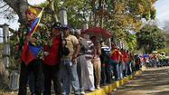 CARACAS, Venezuela -- The funeral ceremony for late Venezuelan President  Hugo Chavez got underway Friday at a military base in the capital before 32 heads of state and with the Simon Bolivar Symphony Orchestra directed by Los Angeles conductor Gustavo Dudamel playing the national anthem.
