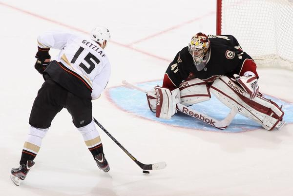 The Ducks' Ryan Getzlaf skates in to score a shootout goal against Phoenix Coyotes' Mike Smith during a March 4 game.