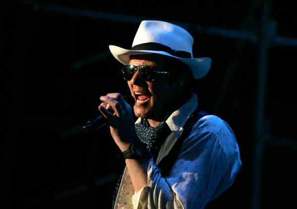 "Singer Scott Weiland, shown performing in New York in July, says, ""No one's ever fired anybody"" from the Stone Temple Pilots, which recently announced it had ""terminated"" Weiland."