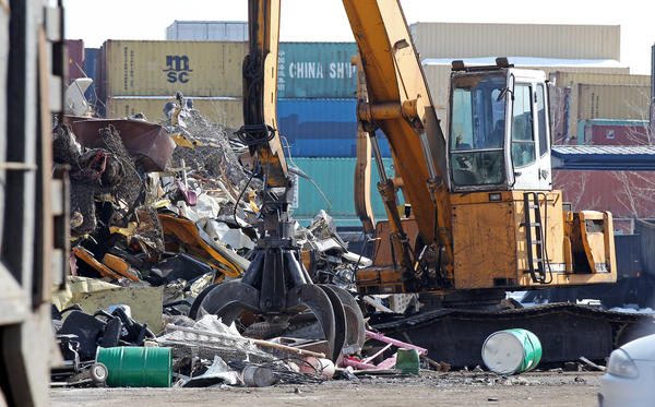 The remains of school buses, left, are seen in a pile of metal at SRV Metal Scrapper.