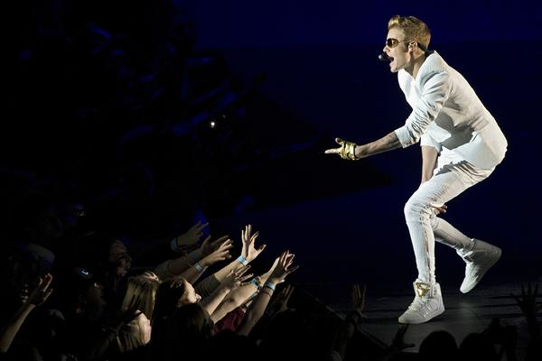 Justin Bieber collapsed Thursday night after suffering breathing problems while playing the third of four shows planned for London's O2 arena.