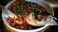 When you tell somebody about a Hunan restaurant, always begin with the steamed fish head. The fish head will be large, probably from an enormous carp or similar freshwater species, thus comical, and it will be frosted with the chopped blend of dried, fresh and fermented chiles that give Hunanese cooking its reputation for head-snapping heat.