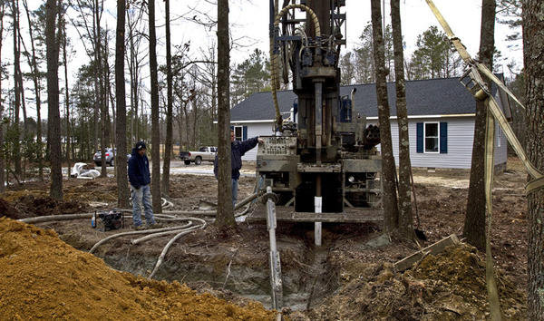 Groundwater Story..Ben Dozier and crew of Toano Well & Pump Service is finishing off this water well drilling they started at this new home yesterday in Charles City Co.