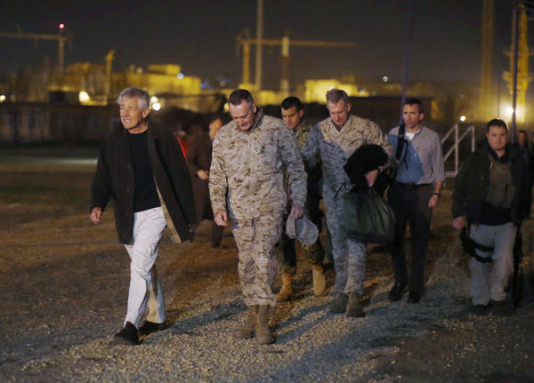 Defense Secretary Chuck Hagel walks with Marine Gen. Joseph Dunford, commander of U.S.-led forces in Afghanistan, after arriving near Camp Eggers in Kabul.
