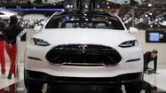Tesla plans to repay loans early, delays Model X