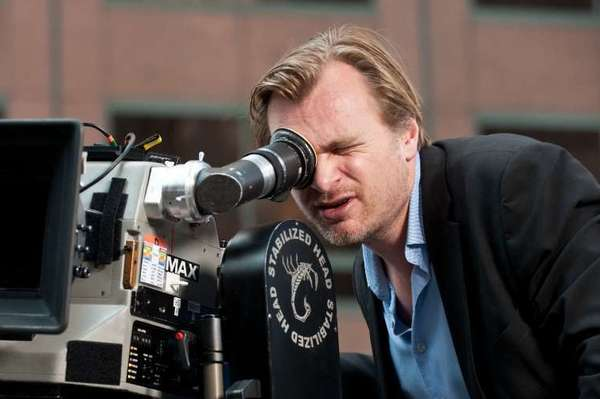 "Christopher Nolan sets up a shot on the set of ""The Dark Knight Rises."""