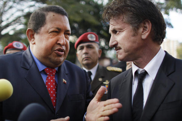 Late Venezuelan president Hugo Chavez, left, talks to actor Sean Penn at the presidential palace in Caracas, Venezuela on Feb. 16, 2012.