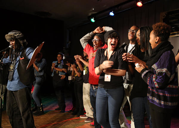 The team from Kenwood Academy celebrates after their first place finish is announced during the Louder Than a Bomb 2013 preliminary bouts at Columbia College Saturday, Feb, 23, 2013, in Chicago. Kenwood won the bout among four schools. (John J. Kim / Chicago Tribune)