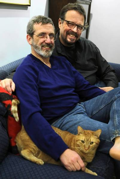 """Dan Maher (left) and Leo Schwartz, with their cat Crackle. """"I knew the relationship was going to last when we each stopped taking the other too seriously,"""" Schwartz says."""