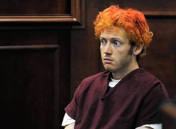 Colorado theater shooting suspect James E. Holmes appears in court in July. A judge has rejected a challenge to state law on insanity pleas and says arraignment can proceed.